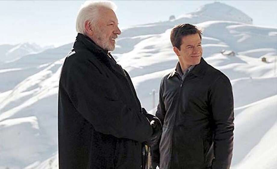 """Donald Sutherland is a father figure to Mark Wahlberg in """"The Italian Job."""""""