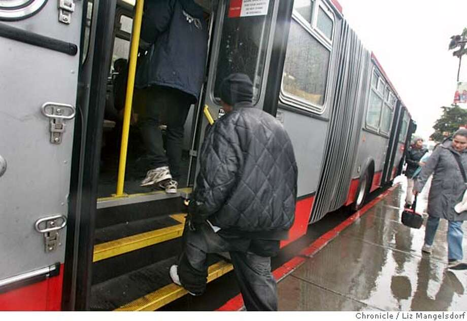 Muni riders board a bus at 16th and Mission Streets from the back, even though signs say it is illegal to board the bus from the back doors. Story is on how MUNI is not collecting all the fares that it could. Photographed on Feb. 26, 2007 . Photo by Liz Mangelsdorf/ San Francisco Chronicle Photo: Liz Mangelsdorf