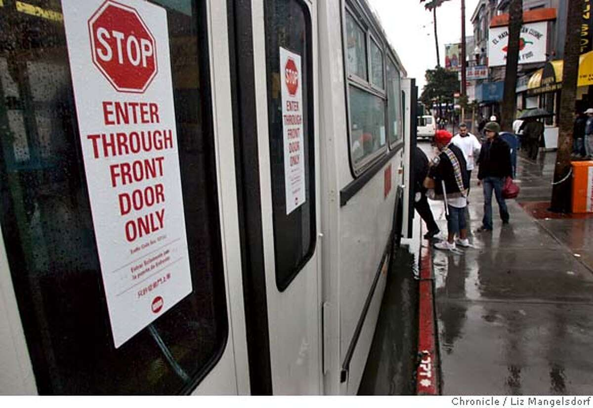 A sign at the back of a bus at 16th and Mission Streets says that it is illegal to board on the back. Story is on how MUNI is not collecting all the fares that it could. Photographed on Feb. 26, 2007 . Photo by Liz Mangelsdorf/ San Francisco Chronicle
