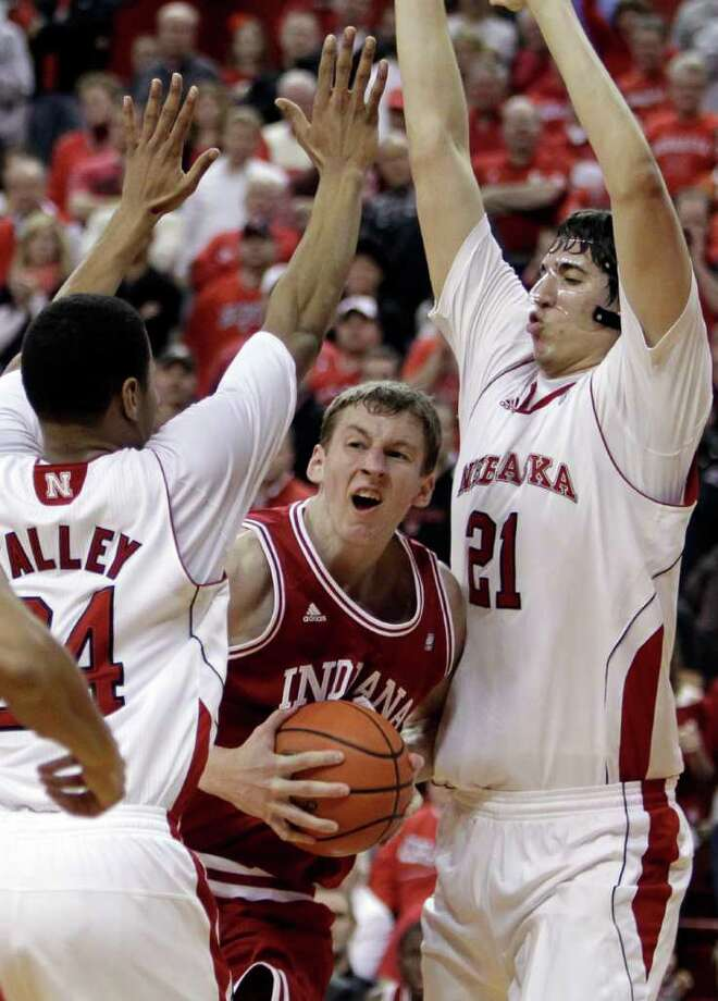 Indiana's Cody Zeller is trapped between Nebraska's Dylan Talley (left) and Jorge Brian Diaz. Photo: AP