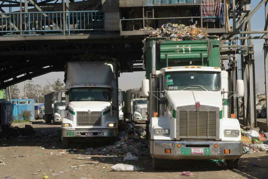 After being picked over for recycable materials, processed garbage is loaded into trailer trucks en route to a sanitary landfill. Photo: Keith Dannemiller / ©2012 Keith Dannemiller