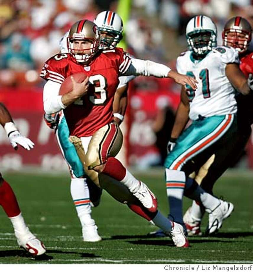 Event on 11/28/04 in San Francisco.  Tim Rattay scrambles in the 1st quarter. The Miami Dolphins beat the San Francisco 49ers 24-17 at Monster Park. Liz Mangelsdorf / The Chronicle Photo: Liz Mangelsdorf