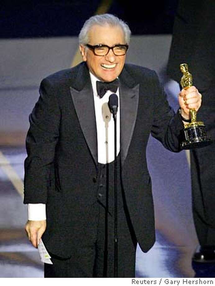 Martin Scorsese accepts his Oscar for best director for 'The Departed' at the 79th Annual Academy Awards in Hollywood, California, February 25, 2007. REUTERS/Gary Hershorn (UNITED STATES) IMAGES FROM THE PRESS ROOM AND SHOW FROM THE 79TH ANNUAL ACADEMY AWARDS ARE EMBARGOED FROM INTERNET, CELL PHONE AND OTHER ONLINE DISTRIBUTION UNTIL THE CONCLUSION OF THE OSCAR TELECAST (APPROX 0400 GMT) AS MANDATED BY THE ACADEMY OF MOTION PICTURE ARTS AND SCIENCES. TEMPLATE OUT Photo: GARY HERSHORN