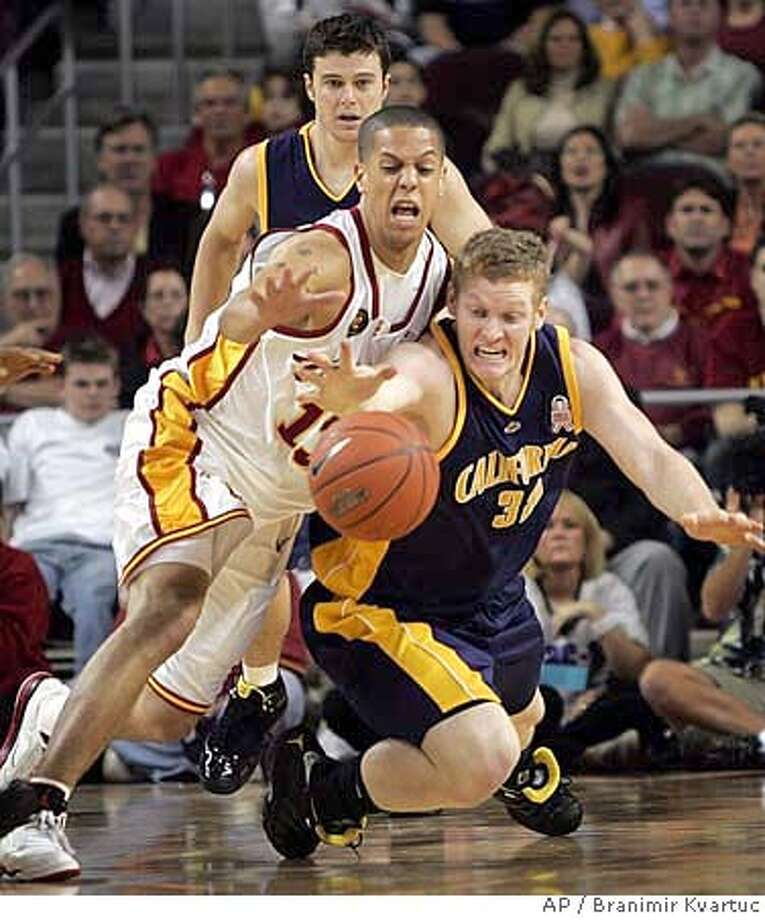 California's Taylor Harrison, right, and Southern California's Daniel Hackett, in white, dive for the ball as Alex Pribble watches from behind during the first half of a college basketball game in Los Angeles on Saturday, Feb. 24, 2007. (AP Photo/Branimir Kvartuc) Photo: Branimir Kvartuc