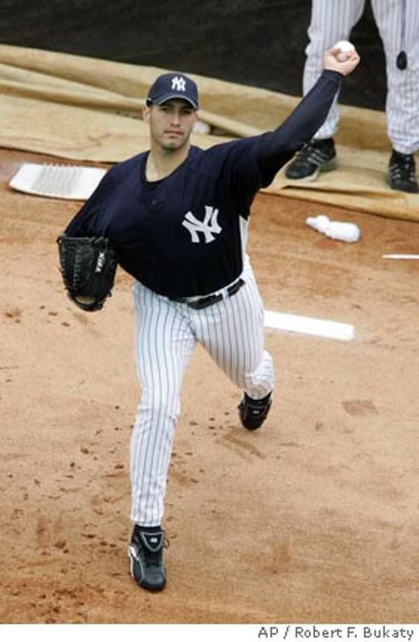 New York Yankees pitcher Andy Pettitte throws off the mound in the bullpen during spring training baseball, Thursday, Feb. 15, 2007, at Legends Field in Tampa, Fla. (AP Photo/Robert F. Bukaty) Photo: ROBERT F. BUKATY