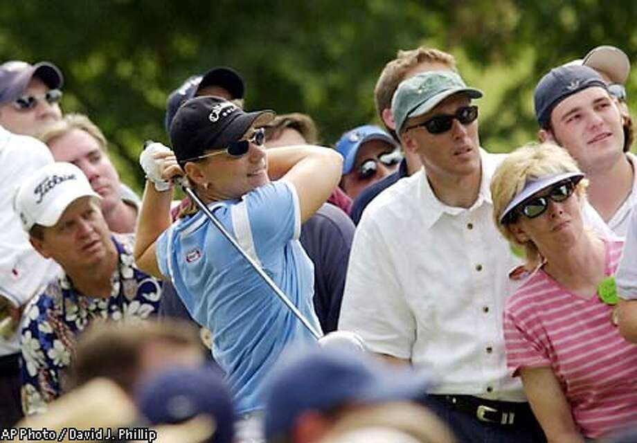 Golfer Annika Sorenstam is surrounded by the gallery as she tees off on the 11th hole during the second round of the Colonial golf tournament at the Colonial Country Club in Fort Worth, Texas on Friday, May 23, 2003. (AP Photo/David J. Phillip) Photo: DAVID J. PHILLIP