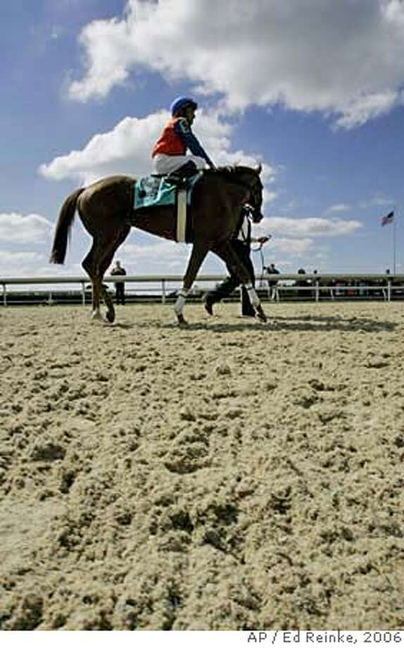 Lordly, with jockey Rafael Bejarno up, is led around the new Keeneland Polytrack surface before entering the winner's circle after winning the inaugural race on the surface Friday, Oct. 6, 2006, in Lexington, Ky. (AP Photo/Ed Reinke)  Ran on: 10-22-2006  Lordly, with jockey Rafael Bejarno up, is led around the new Keeneland Polytrack surface before entering the winner's circle after winning the inaugural race on the surface on Oct. 6.  Ran on: 10-22-2006  Lordly, with jockey Rafael Bejarno up, is led around Keeneland's Polytrack surface before entering the winner's circle. EFE OUT Photo: ED REINKE