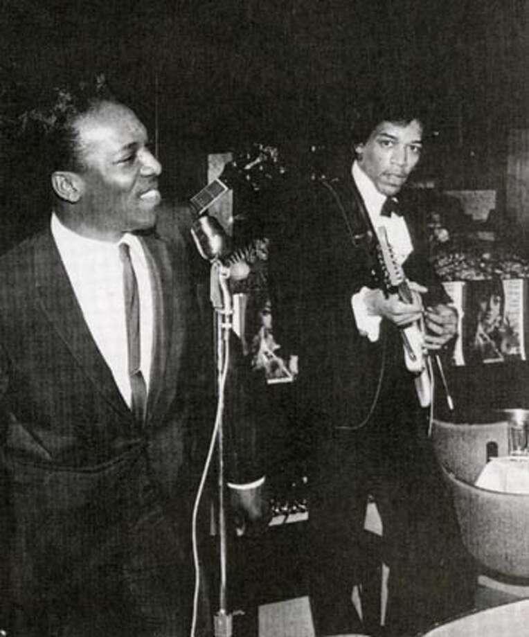 Jimi Hendrix (right) plays backup for Wilson Pickett at an Atlantic Records Party.