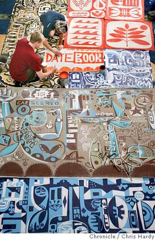 """A couple of artists, Greg """"Pnut"""" Galinsky and Brian Barneclo, painting the Datebook logo and being creative. For pink cover story on ways to jump start your creativity. in San Francisco  8/11/05 Chris Hardy / San Francisco Chronicle Photo: Chris Hardy"""