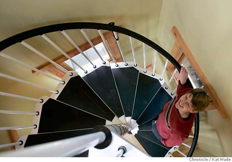 DIFFERENT25_041_KW.jpg  On Sunday February 11, 2007 designer/builder Sallie Lang, walks up the spiral staircase that leads to the garage on the upper level of the Japanese inspired home with eco-friendly elements on Skyline Blvd., in Montclair, built by a team of women . Kat Wade/The Chronicle Mandatory Credit for San Francisco Chronicle and photographer, Kat Wade, No Sales Mags out Photo: Kat Wade