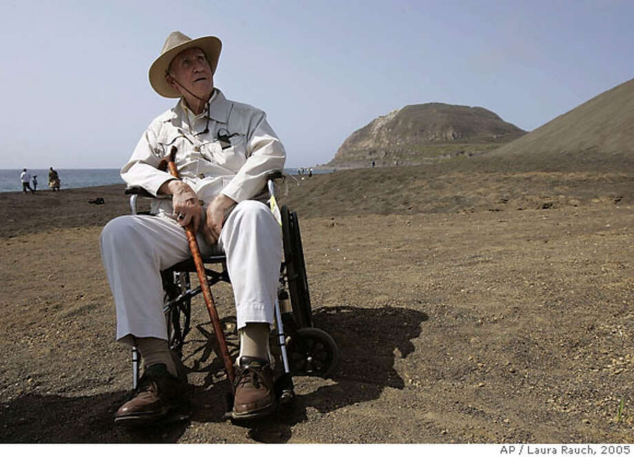 Marine veteran Bill Henderson of Raleigh, N.C., looks out over the beach with Mt. Suribachi in the background during the 60th anniversary of the Battle of Iwo Jima on Iwo Jima, Japan on Saturday March 12, 2005. Aging U.S. veterans converged on the Pacific island of Iwo Jima early Saturday to mark the 60th anniversary of one of the bloodiest and most symbolic battles of World War II. (AP Photo/Laura Rauch) Ran on: 03-13-2005  Photo caption U.S., Japanese veterans mark 60th anniversary on Iwo Jima BC-Japan-Iwo Jima Anniversary, Bjt, 1st Ld-Writethru,0753 U.S., Japanese veterans mark 60th anniversary on Iwo Jima Eds: SUBS graf 7 to say &quo;six troops&quo; raised flag sted Marines AP Photos IJLR101-113 By ERIC TALMADGE Associated Press Writer IWO JIMA, Japan (AP) -- Aging American combat veterans and a handful of former Japanese soldiers gathered on a hillside over the landing beaches of the Battle of Iwo Jima on Saturday to mark the 60th anniversary of one of the bloodiest and most symbolic battles of World War II. About 50 U.S. vets, many dressed in their uniforms and helmets, gathered with hundreds of family members at a Japanese military base on the island. A handful of Japanese survivors -- only about a dozen are still alive -- joined in the &quo;honor reunion,&quo; during which they offered prayers and wreaths for the dead. After the ceremony, they split off to visit battlesites or to pose for photos in a landscape that 60 years ago became a symbol of the savage fighting of the Pacific War. &quo;The battle of Iwo Jima stands out as an exceptionally hard-fought battle in world war history,&quo; said Kiyoshi Endo, who commanded Japanese troops on the northern part of the island. During about a month of fighting that began Feb. 19, 1945, some 100,000 Americans battled more t Photo: LAURA RAUCH