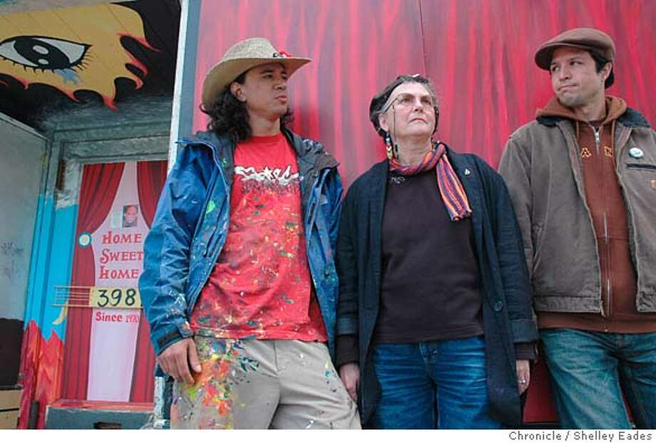 On 8/17/05 in San Francisco Susan Kelk Cervantes, pictured with her sons, Suaro, 26, in cowboy hat and luz, 36,in brown cap, is fighting an eviction and seeking to get landmark status for the Precita Avenue storefront she has lived in for over 35 years. Chronicle Photo by Shelley Eades Photo: Shelley Eades