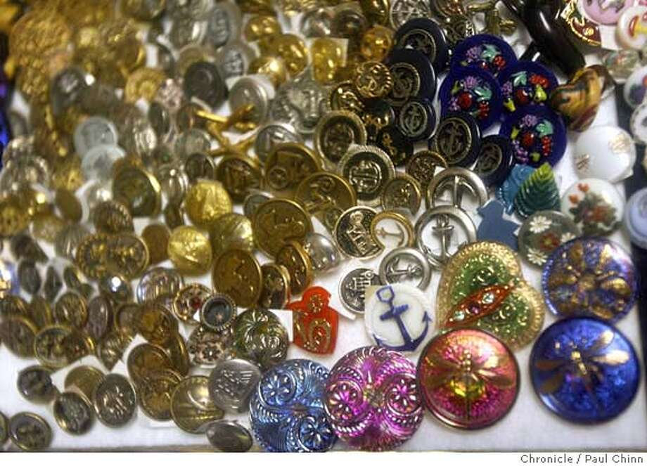 A collection of unique buttons behind an old glass display case at Exclusive Buttons shop in El Cerrito, Calif. on Saturday, February 24, 2007. Long-time shopkeeper Vince Sortile passed away on February 16 at the age of 89.  PAUL CHINN/The Chronicle  **Vince Sortile Photo: PAUL CHINN