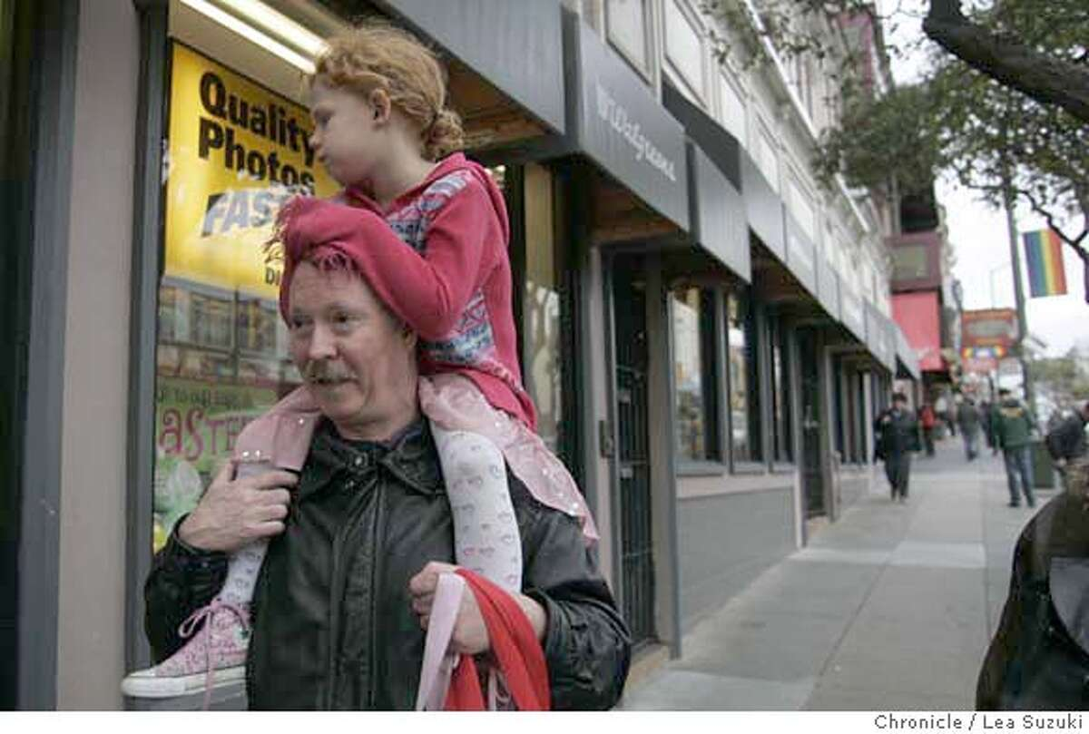 castro25_005_suzuki.JPG Mike Dolan carries his god daughter Ella Swiger, 5, (both of SF) on his shoulders down Castro Street on their way to dinner out in the neighborhood. Story on the leaders in and around one of the world�s most famous gay neighborhood have launched a development effort aimed at keeping it �gay,� especially with redevelopment of upper Market Street in the works. Need to show the changing nature of the neighborhood. Photo taken on 2/21/07, in San Francisco, CA. Photo by Lea Suzuki/ The San Francisco Chronicle Kim Hess-Webb, Rob Webb, Ivy Webb and Breslin Webb (Kim Hess-Webb)cq MANDATORY CREDIT FOR PHOTOG AND SF CHRONICLE/NO SALES-MAGS OUT.