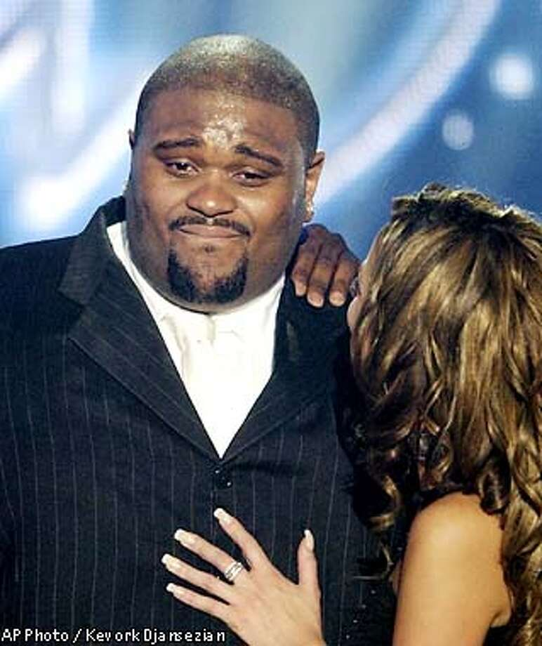 ** IMAGE EMBARGOED UNTIL 1 A.M. EDT, THURSDAY MAY 22, 2003 ** winner Ruben Studdard, from Birmingham, Ala., left, gets emotional as fellow contestant Julia DeMato hugs him at the finale of the show Wednesday, May 21, 2003, in Universal City, Calif. (AP Photo/Kevork Djansezian) Photo: KEVORK DJANSEZIAN