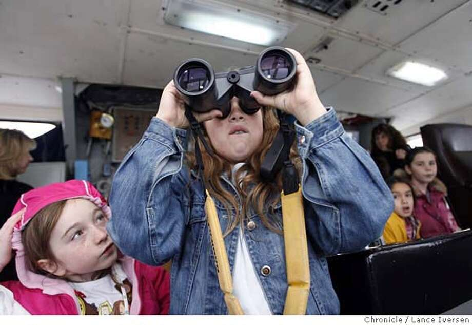 GIRLSCOUTS_7758.JPG  While on the bridge of the Research ship White Holly, docked at Sausalito�s Bay Model, Katie Forrest from troop 1315 in Newark waits her turn for the binoculars as Claire Ratcliff age 9 from troop 326 in Novato scans the horizon. Girl Scouts of San Francisco Bay Area hosts its second annual Career Exploration at Sausalito's Bay Model Visitors Center as part of its Girls Go Tech initiative. The CareerExploration introduces girls to the career fields of science, technology, engineering, and math.Interactive activity tables hosted by leading women in the fields of aerospace, environmental engineering, neuroscience, veterinary care, technology and related fields. The girls also had an opportunity to tour the White Holly, an oceanographic research vessel docked at the facility. February 24, 2007. SAUSALITO.By Lance Iversen/San Francisco Chronicle MANDATORY CREDIT PHOTOG AND SAN FRANCISCO CHRONICLE/NO SALES MAGS OUT Photo: By Lance Iversen