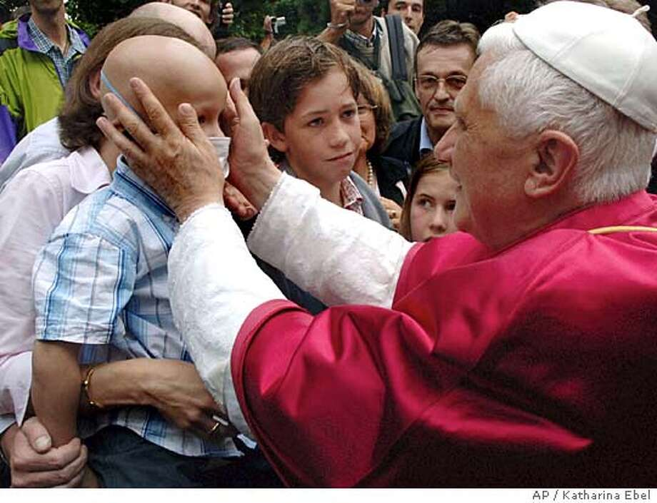 Pope Benedict XVI, right, blesses Victor, who has cancer, in front of the St. Pantaleon church in Cologne, Germany, Friday, Aug 19, 2005. Pope Benedict XVI arrived Thursday on his first foreign trip as pontiff to take part in the Roman Catholic Church's 20th World Youth Day in Cologne. (AP Photo/KNA, Katharina Ebel) ** GERMANY OUT ** GERMANY OUT NO MORE INFORMATION ON THE CHILD AVAILABLE Photo: KATHARINA EBEL