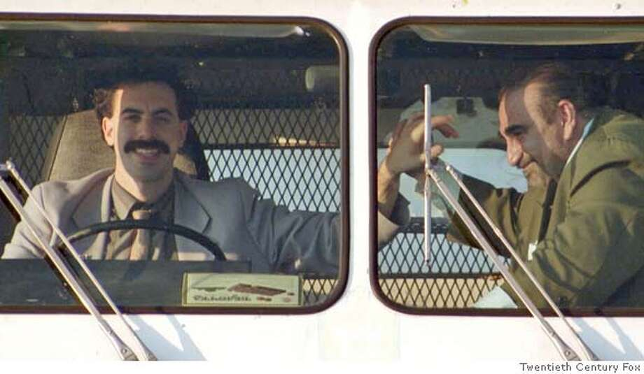 B-15 Borat and Azamat (Ken Davitian) enjoy riding in ice cream truck. (Multiple values) Photo: Twentieth Century Fox