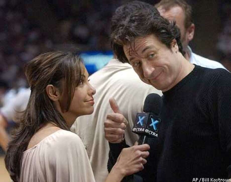 "Joumana Kidd, left, wife of New Jersey Nets' Jason Kidd, interviews Federico Castelluccio, from the television show ""The Sopranos,"" during game 2 of the Eastern Conference semifinals against the Boston Celtics in East Rutherford, N.J., Wednesday May 7, 2003. (AP Photo/Bill Kostroun) Photo: BILL KOSTROUN"