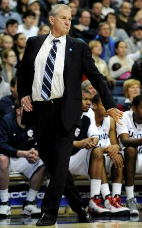 Connecticut head coach Jim Calhoun reacts in the first half of an NCAA college basketball game against Cincinnati in Storrs, Conn., Wednesday, Jan. 18, 2012. Cincinnati won 70-67. (AP Photo/Jessica Hill) Photo: Jessica Hill, Associated Press / AP2012
