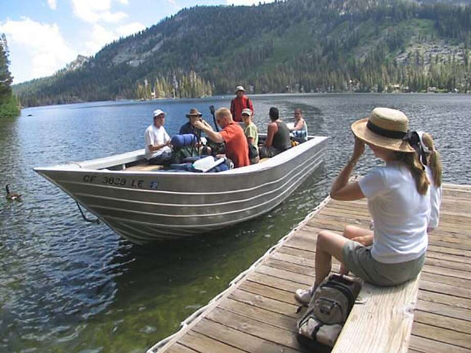 The boat taxi drops a load of hikers at Upper Echo Lake. By saving a couple of hours of walking, it helps make the Desolation Wilderness trek a cushy adventure. Chronicle photo by John Flinn