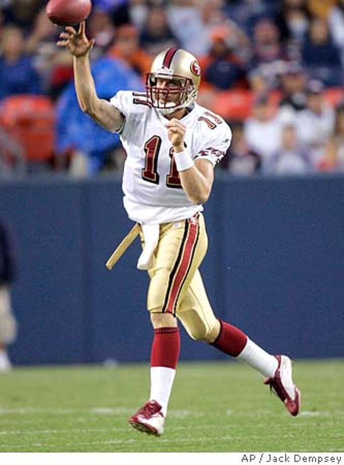San Francisco 49ers quarterback Alex Smith throws a pass against the Denver Broncos during the first quarter at Invesco Field at Mile High in Denver, Saturday, Aug. 20, 2005. (AP Photo/Jack Dempsey) Photo: JACK DEMPSEY