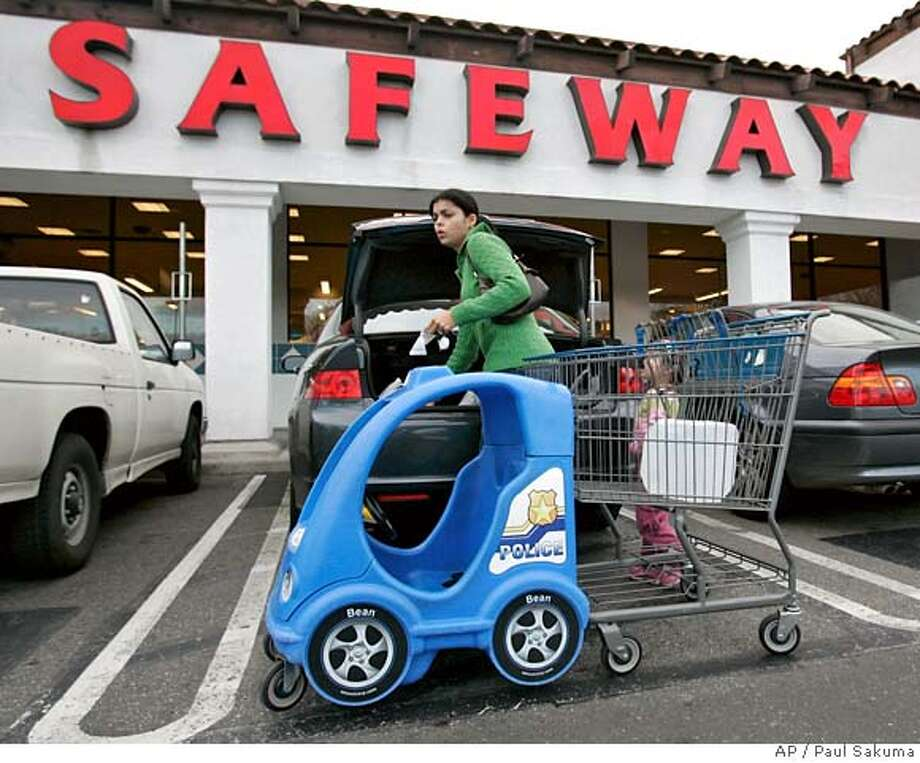 A customer shops at Safeway grocery store in Mountain View, Calif., Thursday, Feb. 22, 2007. Grocery store chain Safeway Inc. said Thursday its fourth-quarter profit climbed 77 percent on higher revenue and a tax gain. Quarterly earnings grew to $307.9 million, or 69 cents per share, in the three months ended Dec. 30 from $173.5 million, or 39 cents per share, in the prior-year period. (AP Photo/Paul Sakuma) Photo: Paul Sakuma