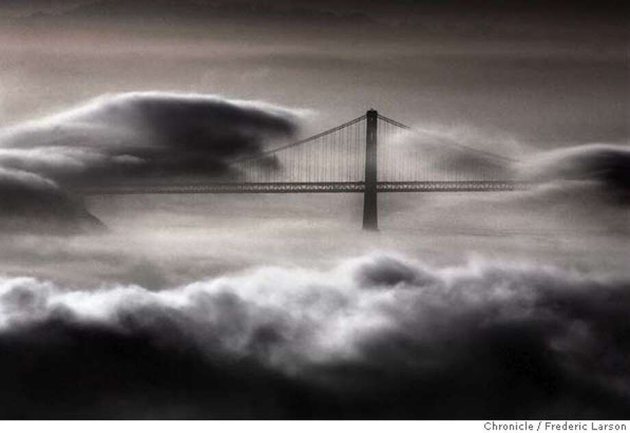 COITSUN437a_fl.jpg Wisps of fog flirts with the Oakland Bay Bridge as summer like weather brings dense morning fog into the bay as seen from the Marin headlands. 3/6/05 San Francisco CA Frederic Larson  The San Francisco Chronicle Photo: Frederic Larson