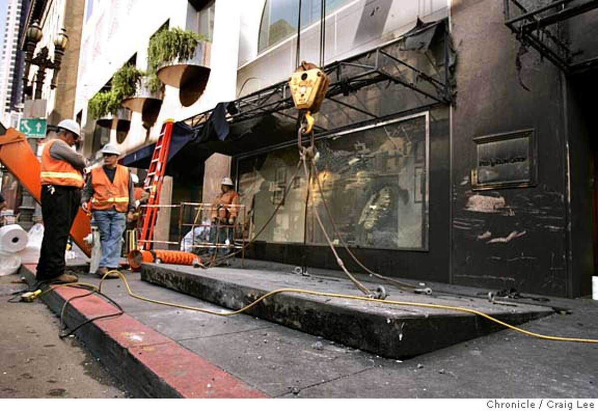 EXPLOSION_058_cl.JPG Explosion cause by a faulty electrical transformer underground which blew up sidewalk and a manhole cover at Kearny and Post streets in front of Polo Ralph Lauren clothing store. The sidewalk that is ajar in the photo is in the same postion after the explosion. Event on 8/19/05 in San Francisco. Craig Lee / The Chronicle MANDATORY CREDIT FOR PHOTOG AND SF CHRONICLE/ -MAGS OUT
