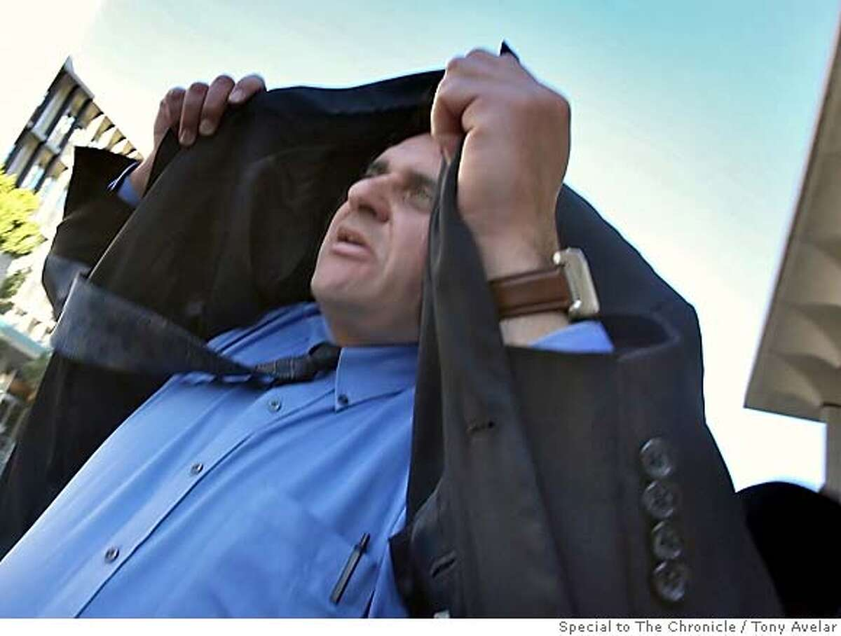 Andrew Bamberg, from Half Moon Bay pulls his jacket over his head as he walks out of the San Mateo County Superior Court house on Friday, Feb. 23, 2007 in Redwood City, Calif. Bamberg is on trial for perjury and may face up to 4 years in prison. By Tony Avelar/SPECIAL TO THE CHRONICLE
