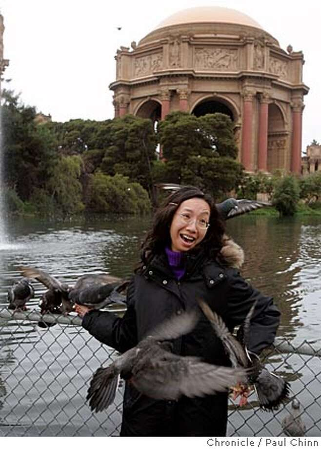 Heidi Chu was overwhelmed by the pigeons she was feeding at the Palace of Fine Arts on 8/9/05 in San Francisco, Calif. Chu and her husband John Wong are regular visitors from Hong Kong and always finish their vacations by feeding the birds at the lagoon. A huge renovation project gets underway Friday when equipment will dredge the 90-year-old lagoon and repair the crumbling shoreline.  PAUL CHINN/The Chronicle Photo: PAUL CHINN