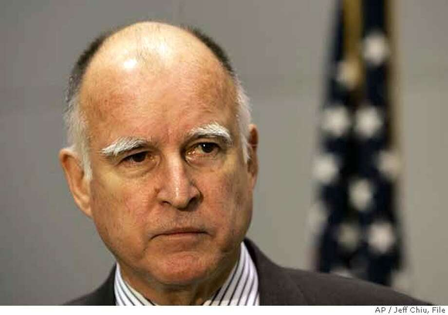California Attorney General Jerry Brown speaks at a news conference in San Francisco, Thursday, Feb. 1, 2007. Brown said Thursday he will pursue a lawsuit against the six largest U.S. and Japanese automakers in which the state seeks millions of dollars in damages caused by vehicle emissions of greenhouse gases. (AP Photo/Jeff Chiu)  Ran on: 02-02-2007  Attorney General Jerry Brown had expressed doubt about the state's case during his campaign.  Ran on: 02-02-2007  Attorney General Jerry Brown had expressed doubt about the state's case during his campaign.  Ran on: 02-02-2007 Ran on: 02-02-2007 Photo: Jeff Chiu
