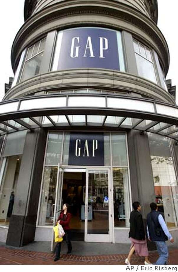 Shoppers walk past the Gap store at Market and Powell streets in San Francisco, Monday Aug. 15, 2005. Gap Inc. on Thursday, Aug. 18, said earnings for the second quarter rose 39 percent, but the retailer warned of a weak sales performance so far this month and lowered its profit forecast for the yea. (AP Photo/Eric Risberg) Photo: ERIC RISBERG