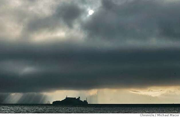 A fog bank rolls above Alcatraz Island, the sun tries to break through, as it creeps across San Francisco Bay. 7/27/05 San Francisco, Ca Michael Macor / San Francisco Chronicle Photo: Michael Macor