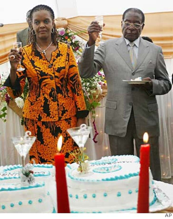 Zimbabwean President Robert Mugabe toasts his 83rd birthday with his wife Grace, left, in Harare, Wednesday, Feb 21, 2007. Police have banned rallies and demonstrations across large swathes of the capital Harare citing pandemonium, looting and destruction of property at the weekend. (AP Photo) ROBERT MUGABE, GRACE MUGABE Photo: AP Photo