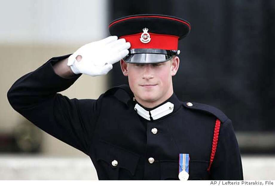 **FILE** Britain's Prince Harry salutes his father Prince Charles (not shown) as he leaves, following The Sovereign's Parade at the Royal Military Academy, where Harry received his military commission at Sandhurst, England in this Wednesday, April 12, 2006 file photo. The Ministry of Defense ended speculation that had been swirling for about a week by announcing Thursday, Feb. 22, 2007, the 22-year-old prince will be sent to Iraq with his Blues and Royals regiment in May or June. Harry, a second lieutenant, will assume a troop commander's role. (AP Photo/Lefteris Pitarakis, FILE) AN APRIL 12, 2006 FILE PHOTO Photo: LEFTERIS PITARAKIS