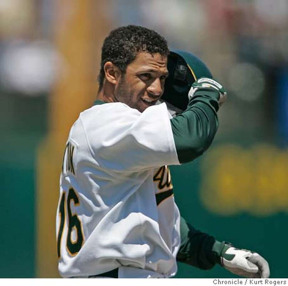 Jay Payton takes off his batting helmet after flying out in the second inning .  Baltimore Orioles Vs. Oakland Athletics at McAfee Coliseum in Oakland .  ATHLETICS_0153_kr.JPG 8/17/05 in Oakland,CA.  KURT ROGERS/THE CHRONICLE MANDATORY CREDIT FOR PHOTOG AND SF CHRONICLE/ -MAGS OUT Photo: KURT ROGERS