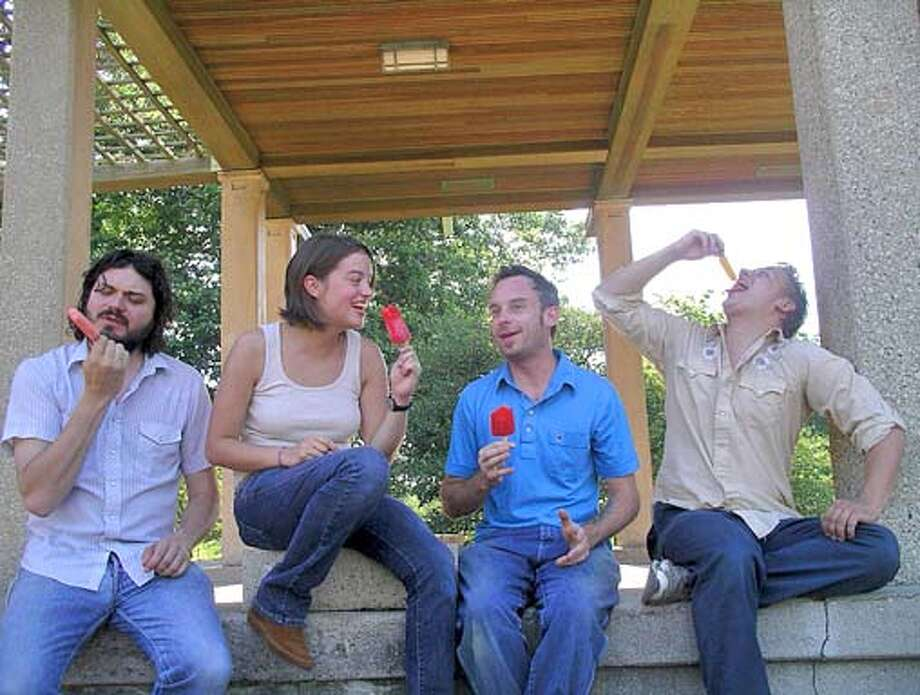 Caption: the band, left to right, are (NAMES TK... WE'RE FINDING OUT RIGHT NOW).