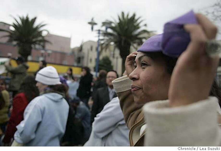 raids22_022_suzuki.JPG Esperanza Barajas of San Francisco dons a purple head scarf which members of Mujeres Unidas wore at the rally. (The group traditionally dons the scarfs at marches and gatherings to show their representation.) Community leaders from Bay Area immigrant communities and Supervisor Chris Daly at rally to take a stand against ongoing immigration raids and reaffirm San Francisco as a sanctuary city at corner of 16th and Mission in San Francisco. Photo taken on 2/21/07, in San Francisco, CA. Photo by Lea Suzuki/ The San Francisco Chronicle  Esperanza Barajas(herself) cq MANDATORY CREDIT FOR PHOTOG AND SF CHRONICLE/NO SALES-MAGS OUT. Photo: Lea Suzuki