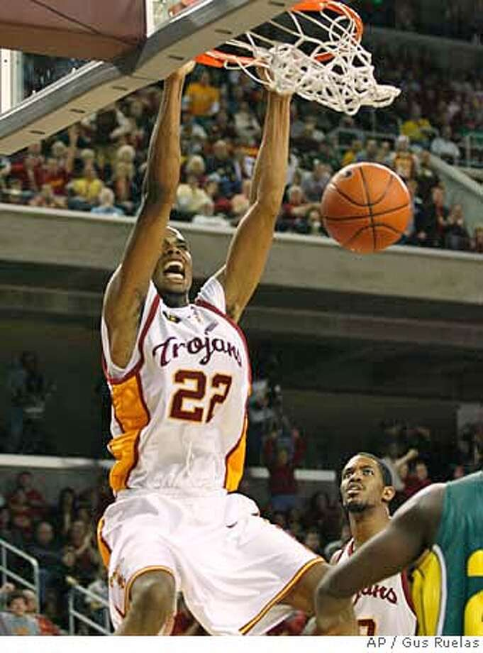 Southern California's Taj Gibson slams for two against Oregon in the second half of their basketball game, Saturday, Feb. 3, 2007 in Los Angeles. USC held on to win over 9th ranked Oregon 71-68 (AP Photo/Gus Ruelas) Photo: Gus Ruelas