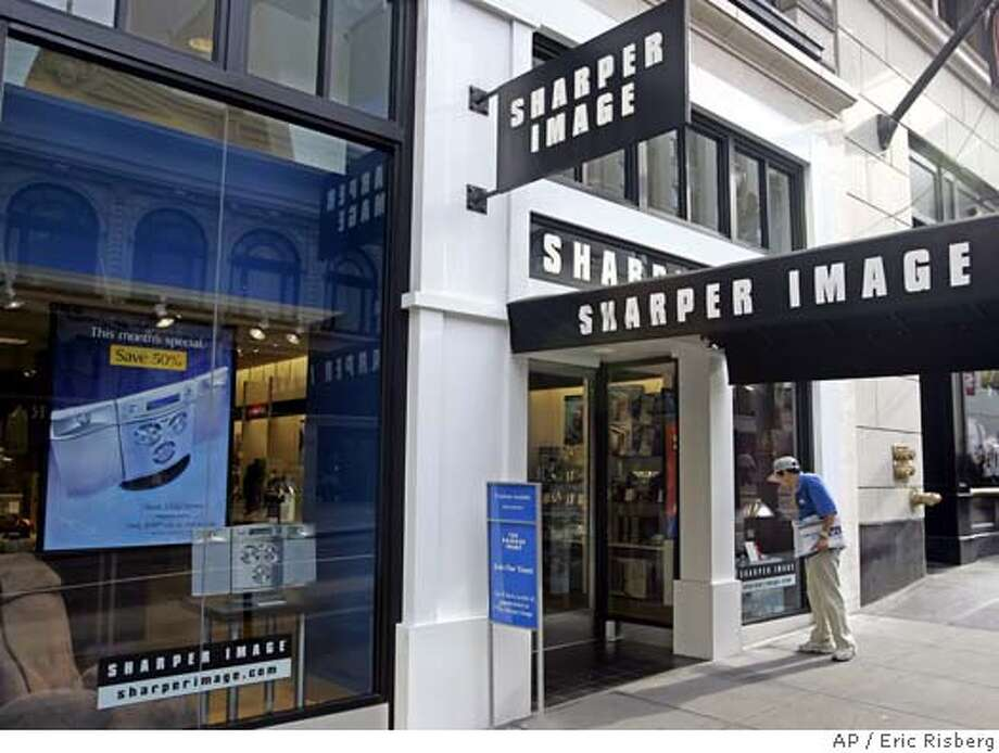A man looks in a window at the Sharper Image store on Post street in San Francisco, Monday Aug. 15, 2005. Sharper Image is expected to report quarterly earnings Thuursday after markets close. (AP Photo/Eric Risberg) Photo: ERIC RISBERG
