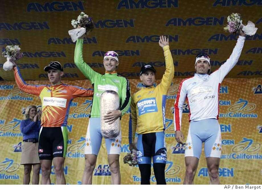Cyclists Brian Sheedy, from left, king of the mountain winner; Jason Donald, second place winner; Levi Leipheimer, prologue winner; and Taylor Tolleson, young rider winner wave to fans during the award ceremony of the Tour of California Sunday, Feb. 18, 2007, in San Francisco. (AP Photo/Ben Margot) EFE OUT Photo: Ben Margot