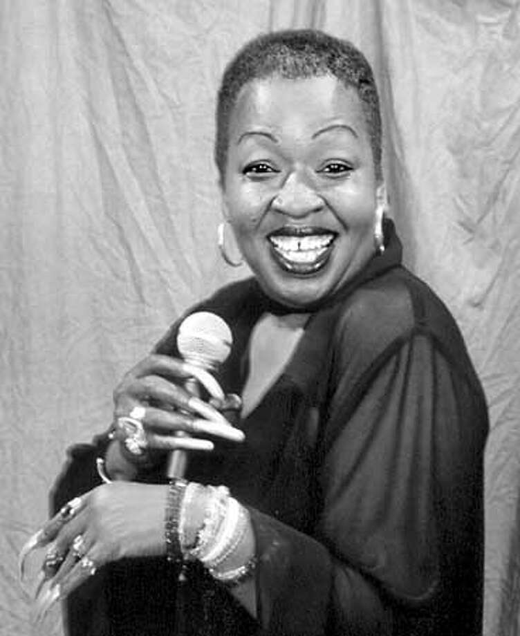 "For BLACK19; Hurwitt review; Lorraine Hansberry Theatre closes season with musical revue ""Black and Blue,"" pictured is singer Faye Carol; 1/1/04 in . / HO"