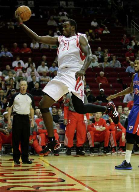 With Samuel Dalembert on the floor - or above it, as was the case in Tuesday's victory over the Pistons at Toyota Center - the Rockets' defense has made impressive strides. Photo: Melissa Phillip / © 2011 Houston Chronicle