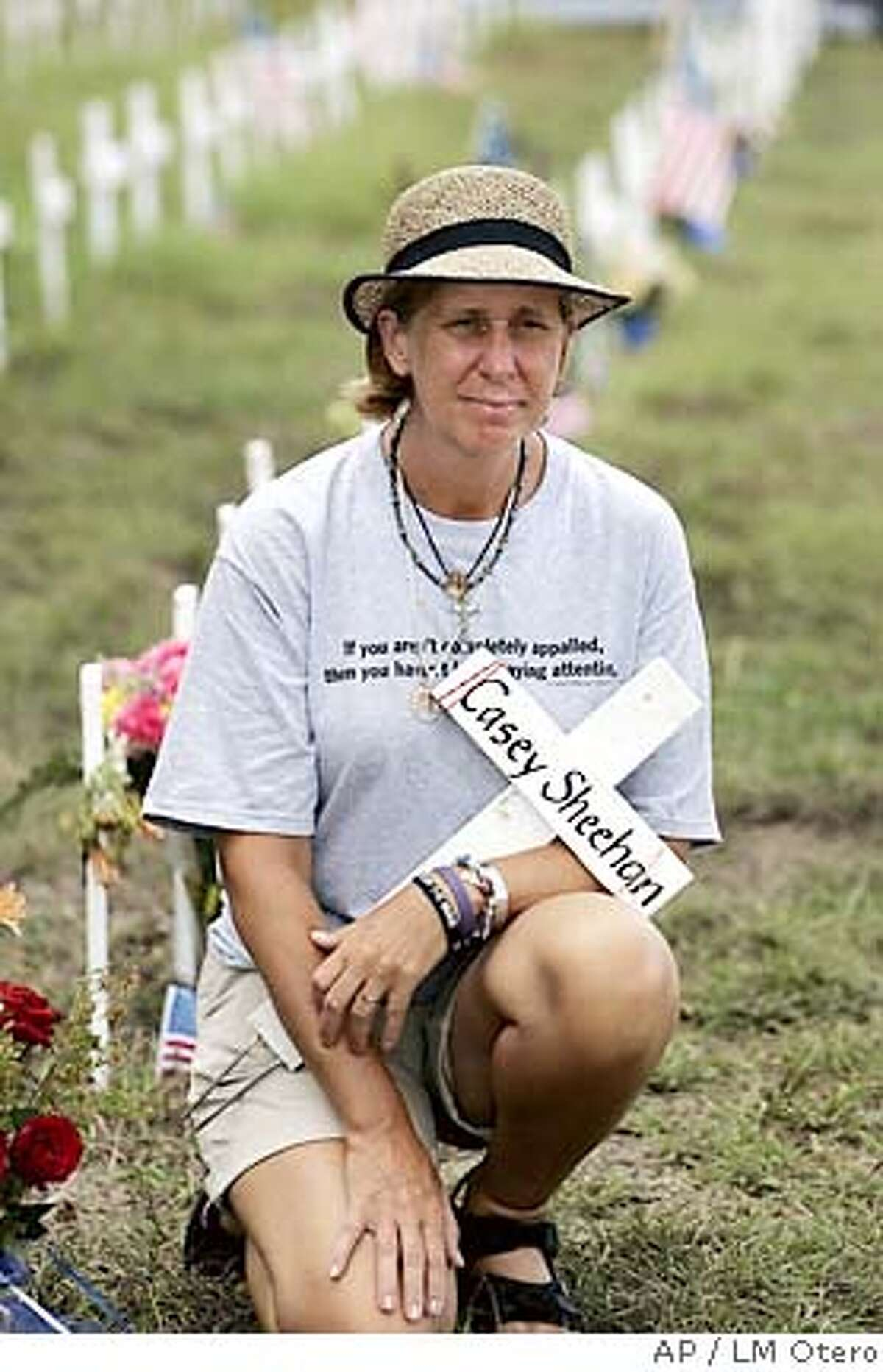 Cindy Sheehan poses for a magazine at her camp on the side of the road leading to President Bush's ranch near Crawford, Texas, Monday, Aug. 15, 2005. Sheehan's vigil to meet with President Bush is entering its' second week. Shehanwhose son CAsey died in Iraq said she will continue her anti-war demonstration for three more wee. (AP Photo/LM Otero) Op-Ed#Op-Ed#Chronicle#8/16/2005#ALL#5star#B6#0423177646 Ran on: 08-16-2005 Cindy Sheehan poses near a row of crosses lining the road to President Bushs Crawford, Texas, ranch. Ran on: 08-16-2005 Cindy Sheehan poses on the side of the road leading to President Bushs ranch. Ran on: 08-16-2005 Cindy Sheehan poses on the side of the road leading to President Bushs ranch.