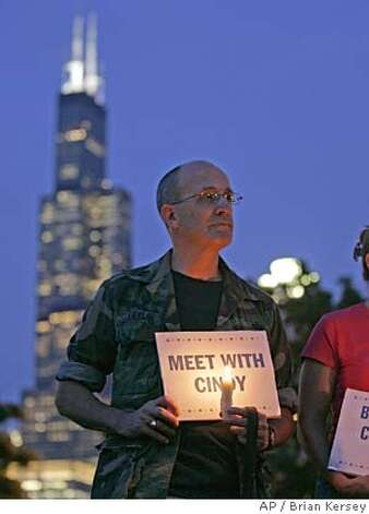 Tom Taylor stands at a candlelight vigil supporting Cindy Sheehan, Wednesday, Aug. 17, 2005, in Chicago. Hundreds of candlelight vigils calling for an end to the war in Iraq got underway Wednesday in a national effort spurred by Sheehan's anti-war demonstration near President Bush's ranch in Texas. (AP Photo/Brian Kersey)  Byline BRIAN KERSEY
