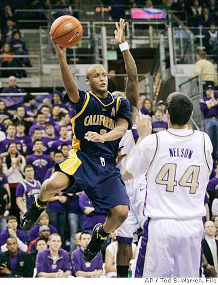 California guard Omar Wilkes looks to pass around Washington forward Phil Nelson (44) and another defender during the first half of a basketball game Thursday, Feb. 8, 2007, in Seattle. (AP Photo/Ted S. Warren) EFE OUT Photo: Ted S. Warren