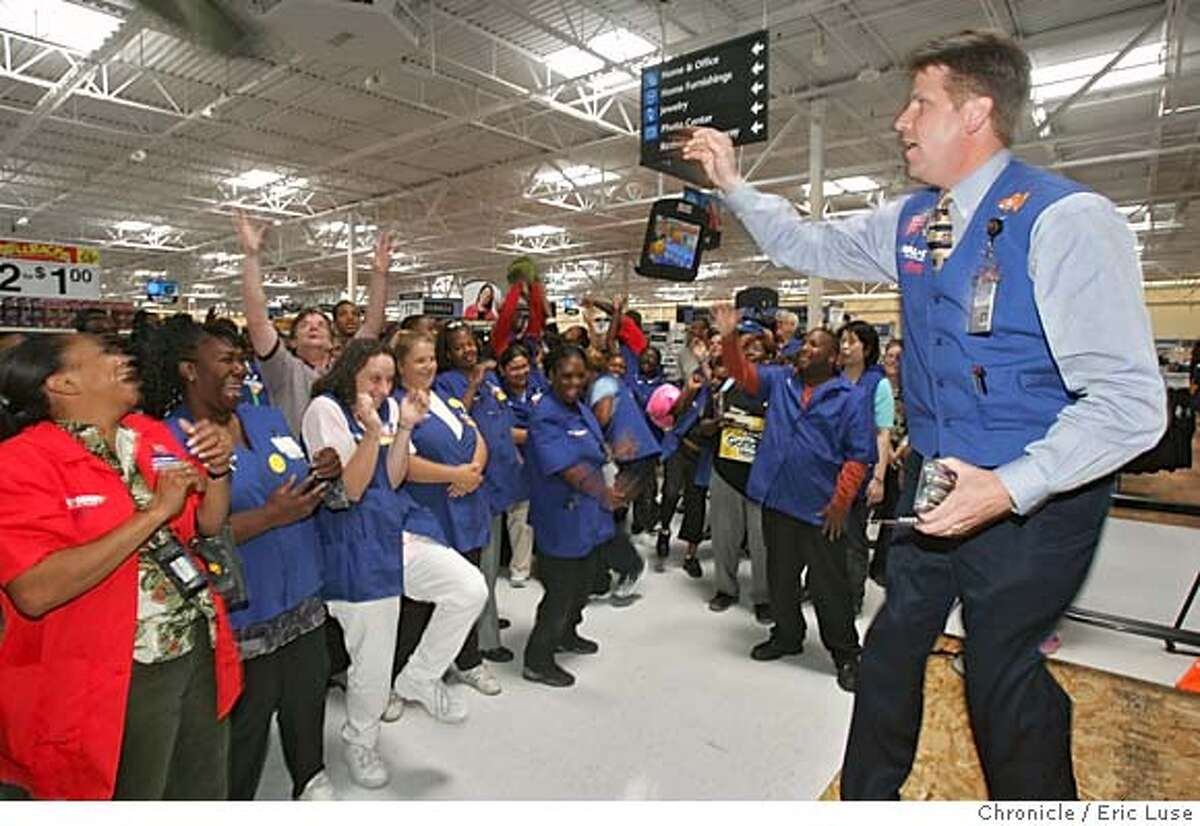 walmart17_025_el.JPG Henry Jordan, regional vice president leading the cheer during the daily meeting to spur enthusiasm for Walmart employees and pumping them up over daily specials to be sold. Walmart is opening a new 148,000 square-foot store in Oakland at 8400 Edgewater Drive, out by the Coliseum and Oakland Airport. It's a press preview day for the news media. Employees and store managers will be availabe for reporters. There will also by a group cheer by the employees. Don't know yet whether we will staff this with a reporter. The schedule is as follows: 12:30 p.m. for guide store tours; 1 p.m. for associate meeting. Photo ops of associates stocking shelves and putting finishing touches on shelves. Also of people interviewing for jobs. 11,000 have applied for 400 jobs. Event on 8/16/05 in Oakland Eric Luse / The Chronicle MANDATORY CREDIT FOR PHOTOG AND SF CHRONICLE/ -MAGS OUT