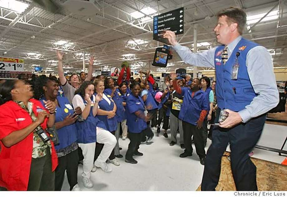walmart17_025_el.JPG  Henry Jordan, regional vice president leading the cheer during the daily meeting to spur enthusiasm for Walmart employees and pumping them up over daily specials to be sold. Walmart is opening a new 148,000 square-foot store in Oakland at 8400 Edgewater Drive, out by the Coliseum and Oakland Airport. It's a press preview day for the news media. Employees and store managers will be availabe for reporters. There will also by a group cheer by the employees. Don't know yet whether we will staff this with a reporter. The schedule is as follows: 12:30 p.m. for guide store tours; 1 p.m. for associate meeting. Photo ops of associates stocking shelves and putting finishing touches on shelves. Also of people interviewing for jobs. 11,000 have applied for 400 jobs. Event on 8/16/05 in Oakland Eric Luse / The Chronicle MANDATORY CREDIT FOR PHOTOG AND SF CHRONICLE/ -MAGS OUT Photo: Eric Luse