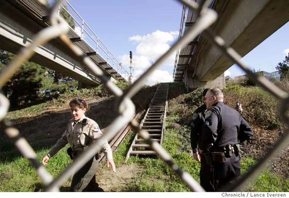 MTLION_7265.JPG  Nicole Kozicki from Ca Fish & Game and Sgt Keith Curlett and Sgt Gerald Dominquez both Bart Police officers converge on the area at the Bart Fremont station were two Mountain Lions were spotted sunning themselves next to the tracks Tuesday. February 20, 2007.FREMONT.By Lance Iversen/San Francisco Chronicle Ran on: 02-21-2007  Nicole Kozicki of the state Fish and Game Department and Sgts. Keith Curlett and Gerald Dominquez of the BART police patrol along the tracks near the Fremont Station after reports of the sighting of two mountain lions Tuesday. The search, which included the use of a helicopter with heat-sensing equipment, failed to find signs of the animals. The possible sightings of &quo;some sort of creature that was at least larger than a German shepherd&quo; did not cause delays, said BART spokesman Linton Johnson.  Ran on: 02-21-2007 Ran on: 02-21-2007  Nicole Kozicki of the state Fish and Game Department and Sgts. Keith Curlett and Gerald Dominquez of the BART police patrol along the tracks near the Fremont Station after reports of the sighting of two mountain lions Tuesday. The search, which included the use of a helicopter with heat-sensing equipment, failed to find signs of the animals. The possible sightings of &quo;some sort of creature that was at least larger than a German shepherd&quo; did not cause delays, said BART spokesman Linton Johnson.  Ran on: 02-21-2007 Ran on: 02-21-2007 Ran on: 02-21-2007 Photo: By Lance Iversen